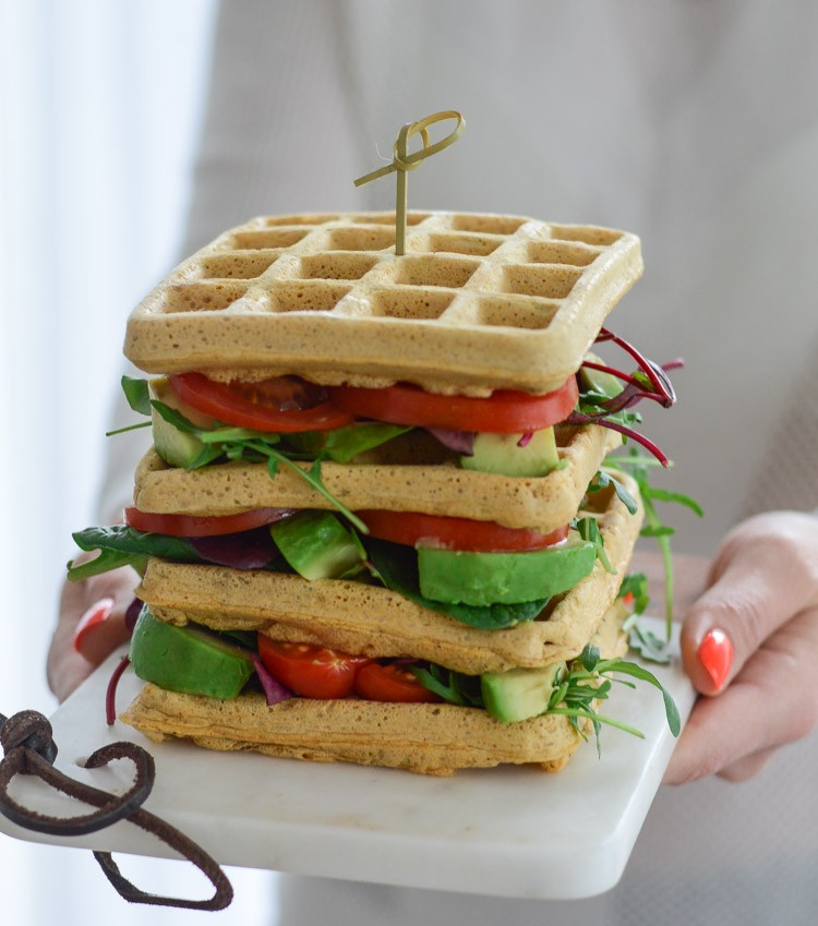 Close up view of vegan chickpea waffle sandwich stack
