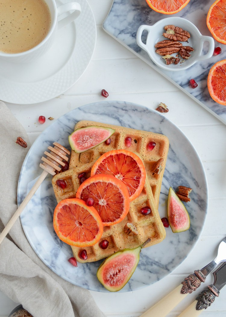 top down view of vegan chickpea waffle topped with blood orange, figs and pecans