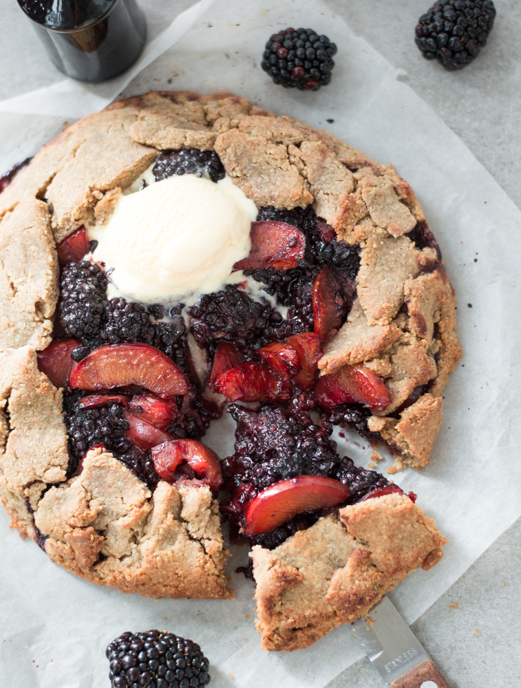 Top down view of plum & blackberry galette  with a scoop of ice cream