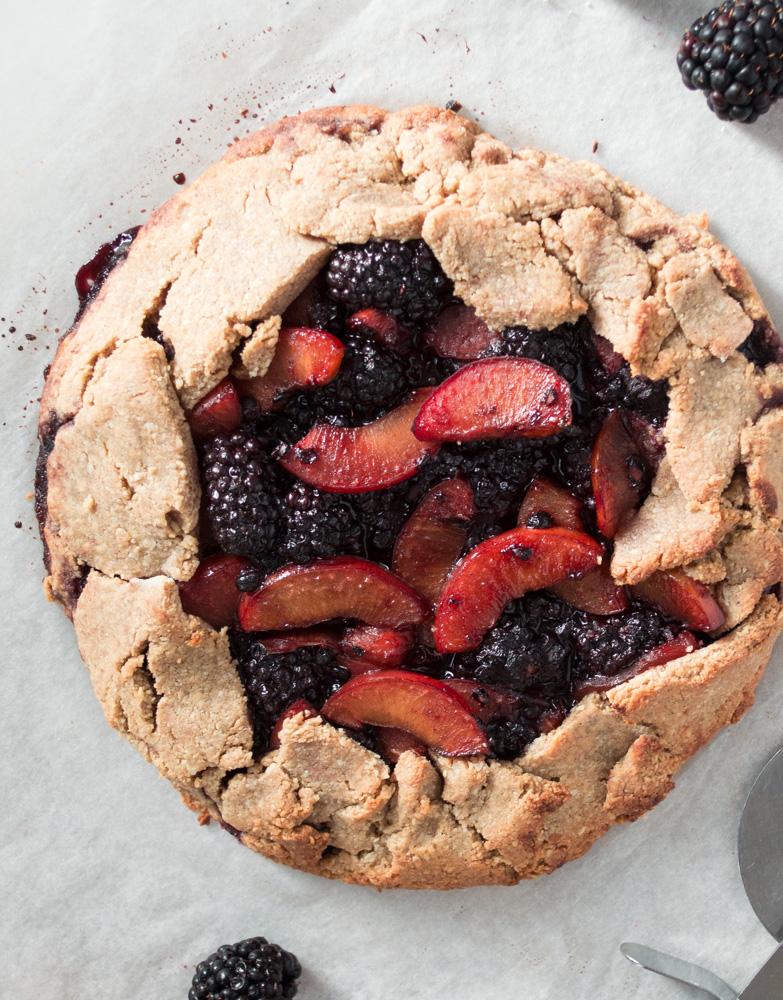 Top down view of freshly baked plum & blackberry galette