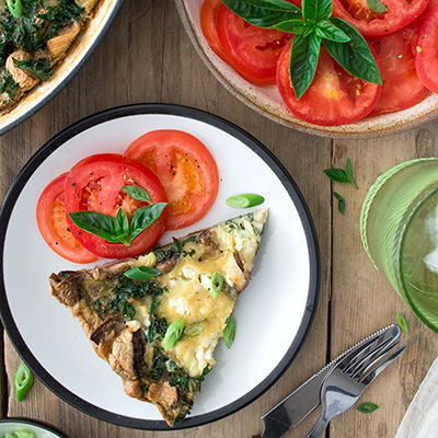 Frittata slice with sliced tomatoes