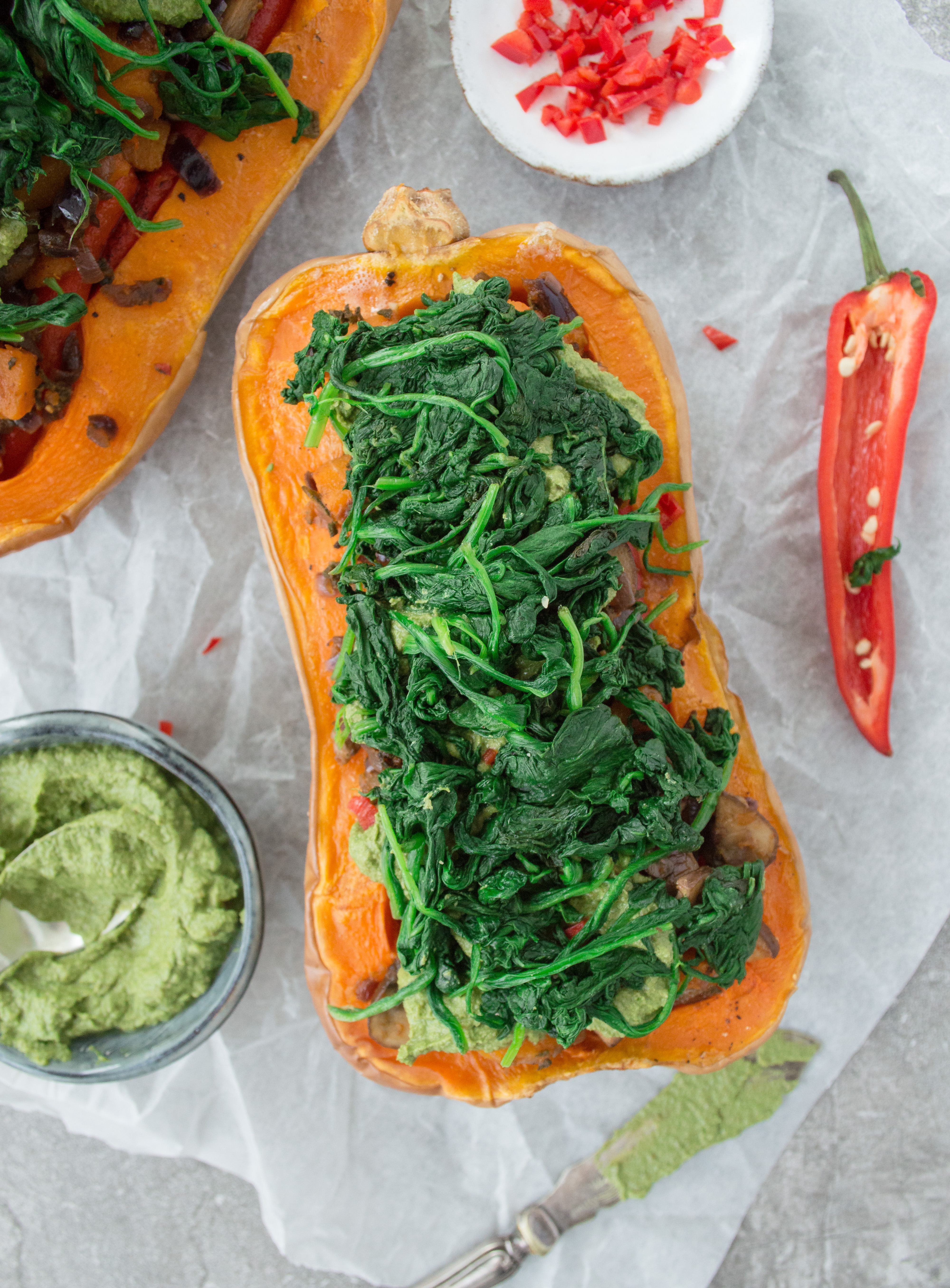 Butternut squash halves stuffed with spinach and vegetables