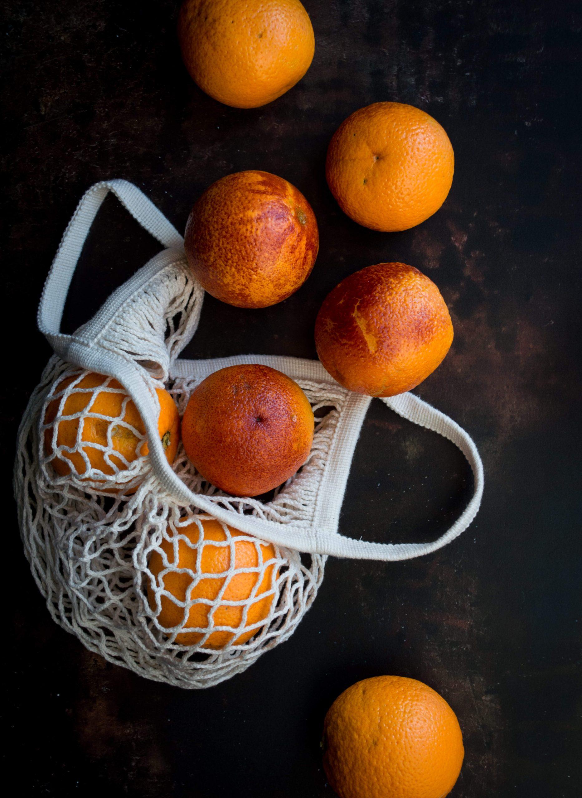 Blood oranges on dark background