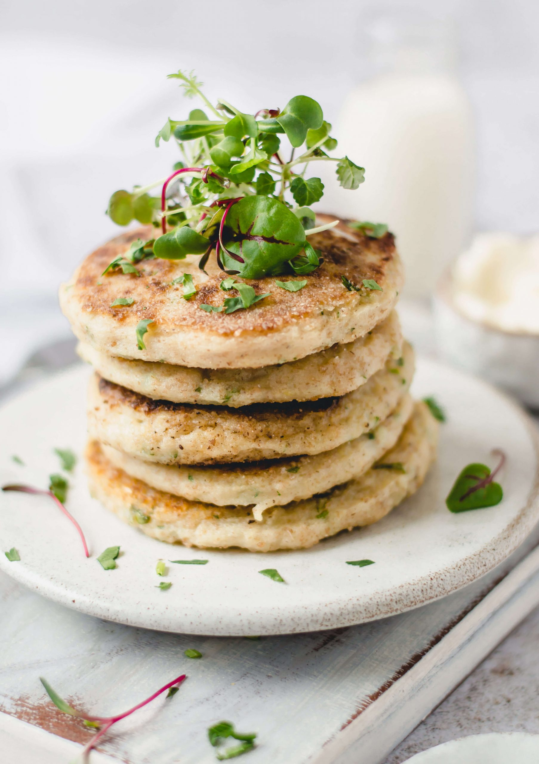 Vegan potato cakes stack garnished with herbs