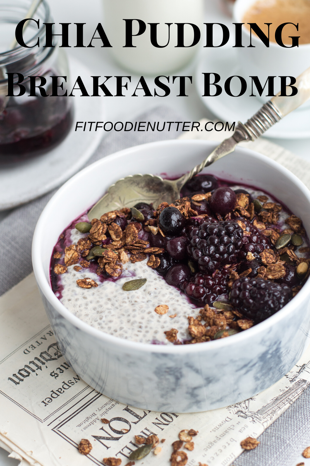 Chia pudding, berry compote & chocolate granola in a bowl