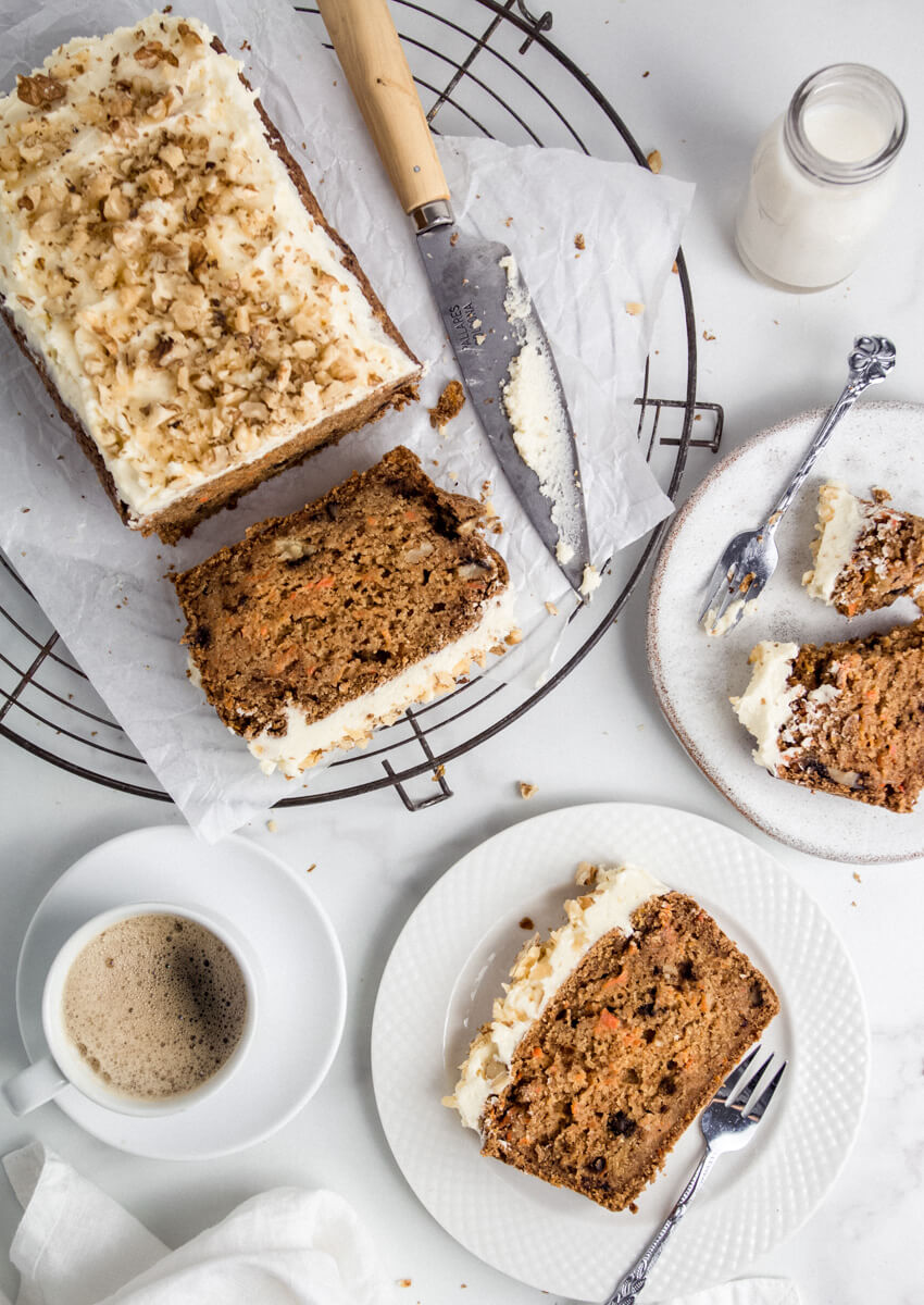 Top down view of sliced vegan carrot cake and coffee