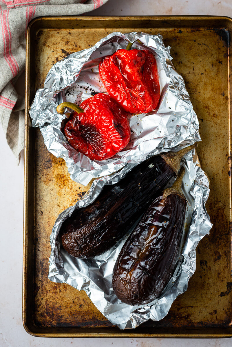Roasted red bell peppers and aubergines in baking foil