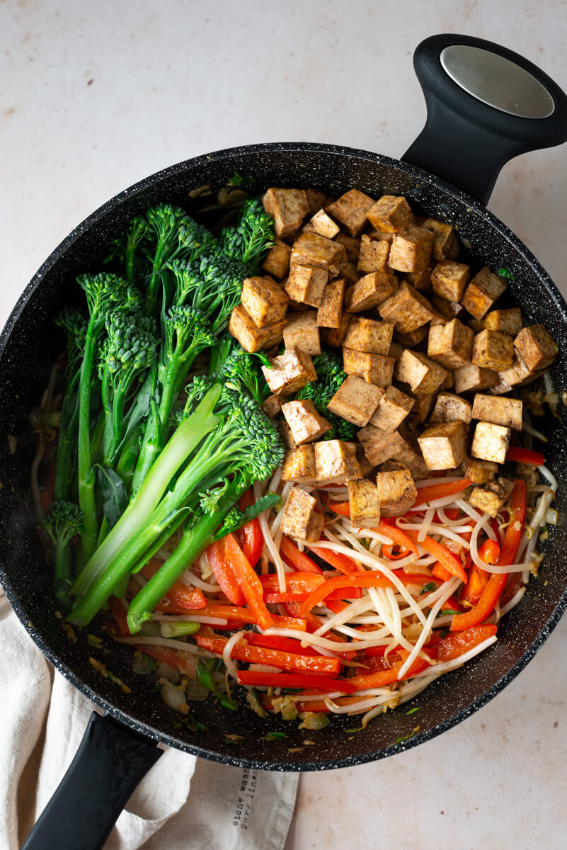 Overhead view of fried vegetables in a pan for making vegan Pad Thai